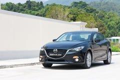 Prova su strada 2014 di versione di Mazda3 JDM Giappone Immagine Stock