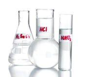 Prova-tubi con i vari acidi Immagine Stock