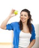Provando uma maçã Imagens de Stock Royalty Free