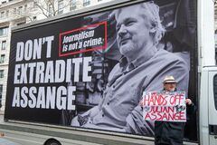 Protester against Julian Assange`s extradition to the USA.