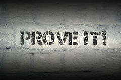 Prove it GR. Prove it stencil print on the grunge white brick wall Stock Image