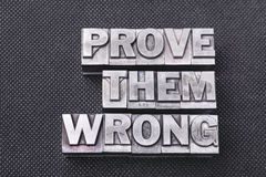 Prove them wrong bm. Prove them wrong phrase made from metallic letterpress blocks on black perforated surface Stock Photography