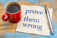 Prove them wrong - napkin concept. Prove them wrong  - handwriting on a napkin with a cup of coffee Royalty Free Stock Image