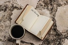 Prove them wrong quote on a notebook and a coffe cup near it. Motivational text Royalty Free Stock Photography