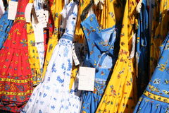 Provençal colors. Brightly colored traditional dresses on a market stall in Provence Royalty Free Stock Photo