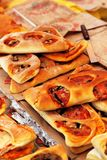 Provencal bread fougasse typical Mediterranean cuisine. The Provençal flat bread known as Fougasse with olives, cheese, garlic, herbs or anchovies.On the market stock photo