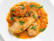Provencal chicken from above. Provencal chicken breasts, a simple French classic of floured fried chicken and a tomato, garlic, anchovy, wine and herbs royalty free stock photos