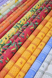 Provencal fabrics. Traditional Provencal patterns on rolls of cotton at a local market royalty free stock photo