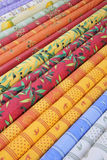 Provencal fabrics. Traditional Provencal patterns on cotton at a local market stock photos