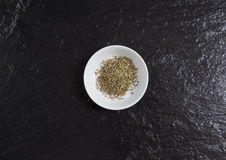 Provencal herbs in a bowl on a slate Stock Images
