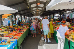 Provencal market in Cannes, French Riviera, France. Cannes, France - August 05, 2016: Provencal market in Cannes with unidentified people. Cannes is well known royalty free stock photos
