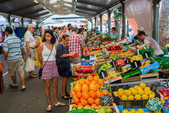 Provencal market in Cannes, French Riviera, France. Cannes, France - August 05, 2016: Provencal market in Cannes with unidentified people. Cannes is well known royalty free stock photography