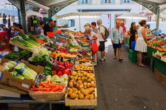 Provencal market in Cannes, French Riviera, France. Cannes, France - August 05, 2016: Provencal market in Cannes with unidentified people. Cannes is well known royalty free stock images