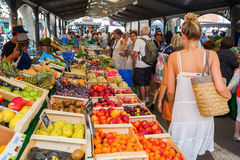 Provencal market in Cannes, French Riviera, France. Cannes, France - August 05, 2016: Provencal market in Cannes with unidentified people. Cannes is well known royalty free stock photo