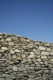 Provencal stone wall blue sky background Stock Photo