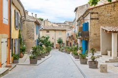 Provencal street with typical houses in southern France, Provenc Stock Images