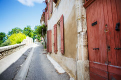 Provencal street with typical houses in southern France, Provenc Stock Photography
