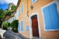 Provencal street with typical houses in southern France, Provenc Stock Photos