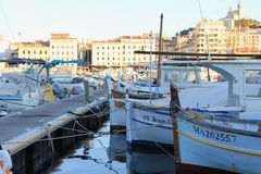 Marseille Old port south France at sunset. Provence Côte d'Azur, France - boats at Marseille old port (Vieux port), view on port, boats and fameous Cathedral of Royalty Free Stock Photography