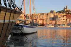 Marseille Old port south France at sunset. Provence Côte d'Azur, France - boats at Marseille old port (Vieux port), view on port, boats and fameous Cathedral of Stock Photo