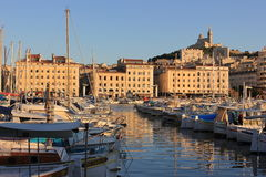 Marseille Old port south France at sunset. Provence Côte d'Azur, France - boats at Marseille old port (Vieux port), view on port, boats and fameous Cathedral of Royalty Free Stock Photos