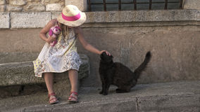 Girl in Provence. A girl petting a black cat in Provence Stock Photo