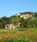 Provence hilltop village. Hilltop village Moissac-Bellevue in Provence, France with a meadow with poppies Stock Image