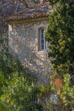 Provence quarrystone house. A quarrystone house wall in the Provence Stock Photography