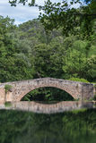 Provence - Roman bridge reflected in the river caramy Royalty Free Stock Images