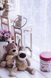 Provence style interior. Warm and cozy window seat with Teddy Bears and flowers. Light home decoration in pink and purple tones. Retro living room Stock Images