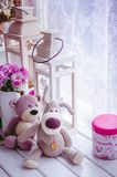 Provence style interior. Warm and cozy window seat with Teddy Bears and flowers. Light home decoration in pink and purple tones. Retro living room Royalty Free Stock Image