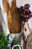 Provence style rustic kitchen interior, wood cutting boards, hanging linen towel, string with dry peppers Royalty Free Stock Photos