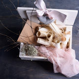Provence style wedding background. Vintage scrolls, envelopes, ceramic heart with pink silk lace in white wooden box. Royalty Free Stock Photo
