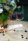 Provence summer still life  with flowers,  glasses and blueberry Royalty Free Stock Image