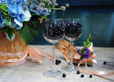 Provence summer still life  with flowers,  glasses and blueberry Royalty Free Stock Photo