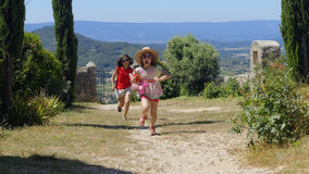 Provence. Two girls running on a path in Provence, France Royalty Free Stock Photo