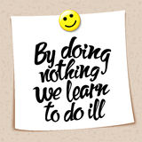 Proverb By doing nothing we learn to do ill Stock Images