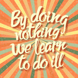 Proverb By doing nothing we learn to do ill Royalty Free Stock Photo