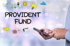 PROVIDENT FUND. Person holding a smartphone on blurred cityscape background Stock Photos