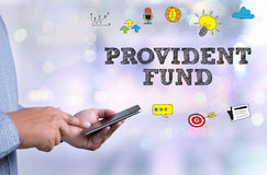 PROVIDENT FUND. Person holding a smartphone on blurred cityscape background Stock Photography