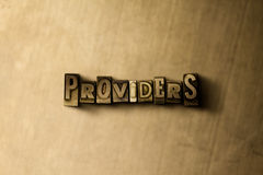 PROVIDERS - close-up of grungy vintage typeset word on metal backdrop Stock Image