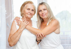 Providing care for elderly. Providing care and support for elderly Stock Images
