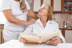 Providing care for elderly royalty free stock images