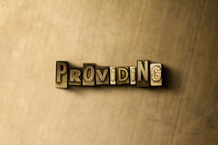 PROVIDING - close-up of grungy vintage typeset word on metal backdrop. Royalty free stock illustration.  Can be used for online banner ads and direct mail Royalty Free Stock Photo