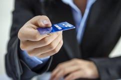 Providing credit card. Bank office worker providing credit card Royalty Free Stock Photos