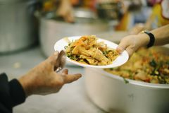Providing food to the poor is helping sharing from fellow humans together : Concept of famine and social inequality royalty free stock photography