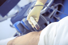 Providing ultrasonic exam to the patient in clinic Royalty Free Stock Image