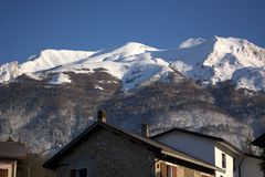 The first snow on Mount Serva, symbol of the city of Belluno Royalty Free Stock Images