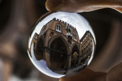 Province palace in Bologna,  in a crystal ball Royalty Free Stock Photo