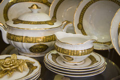 Province style tableware. In white and golden color at shelf in shop Stock Image